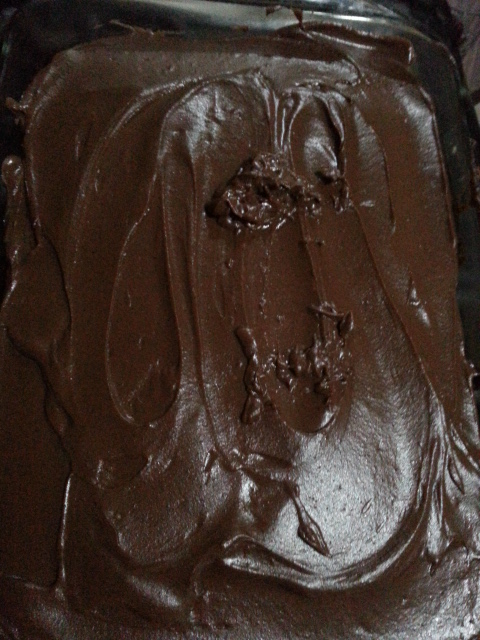 Rich chocolate cake with cooked custard style cacao and wine frosting.